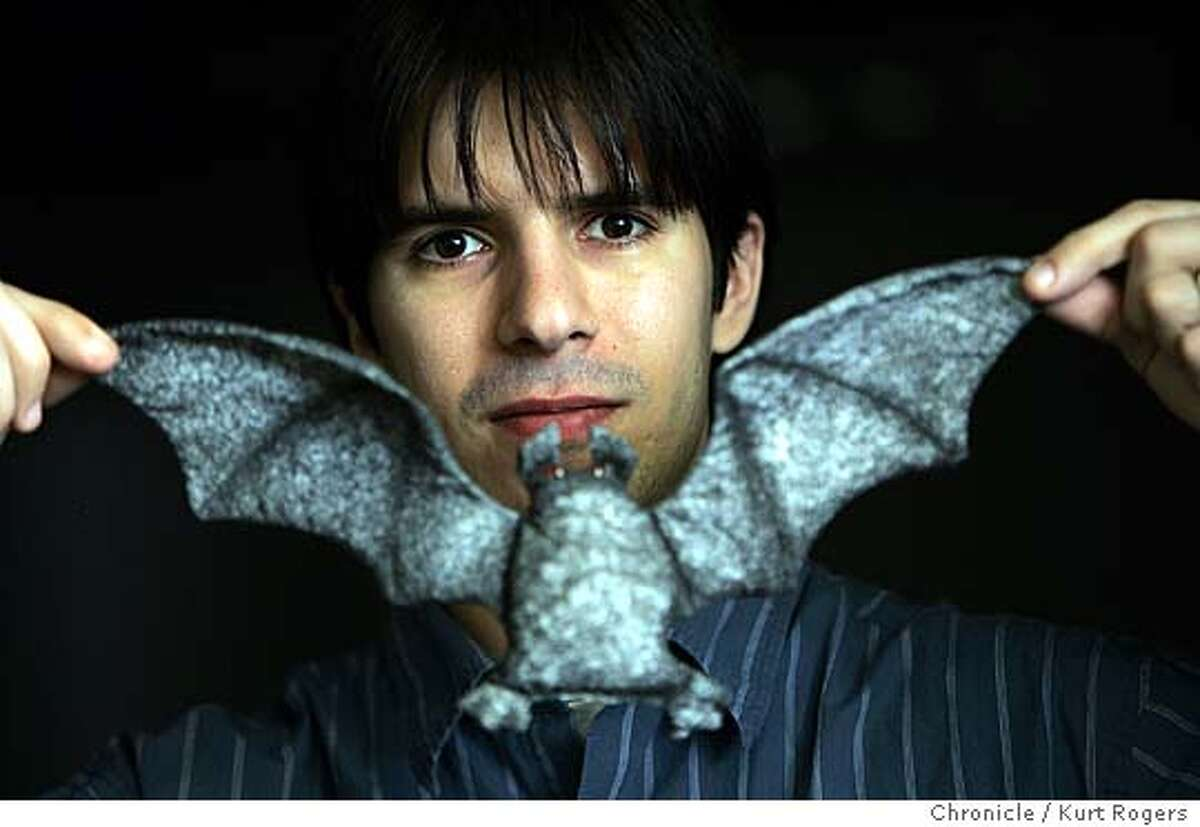 """Andrew Farago is the Gallery Manager.and is holding a bat that will be part of the show. """"Gross, Gruesome and Gothic"""" exhibition at the Cartoon ARt Museum, Andrew Farago is the Gallery Manager. 9/15/05 in San Francisco,CA. KURT ROGERS/THE CHRONICLE"""