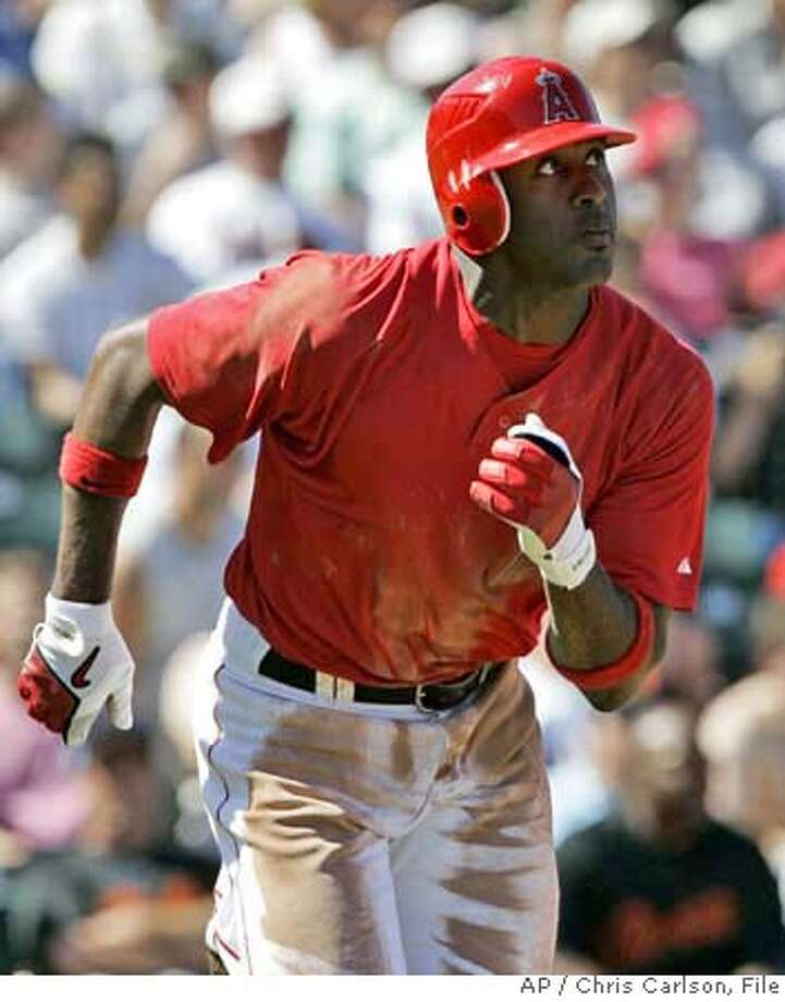 Los Angeles Angels' Gary Matthews Jr. watches is home run against the San Francisco Giants, during the fourth inning of their spring training baseball game in Tempe, Ariz., Wednesday, March 14, 2007. (AP Photo/Chris Carlson) EFE OUT Photo: Chris Carlson