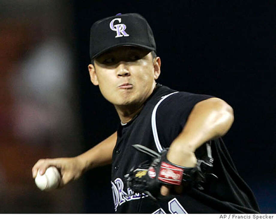 Colorado Rockies pitcher Sunny Kim throws against the Los Angeles Dodgers in the first inning in Los Angeles on Tuesday, Sept. 13, 2005. (AP Photo/Francis Specker)