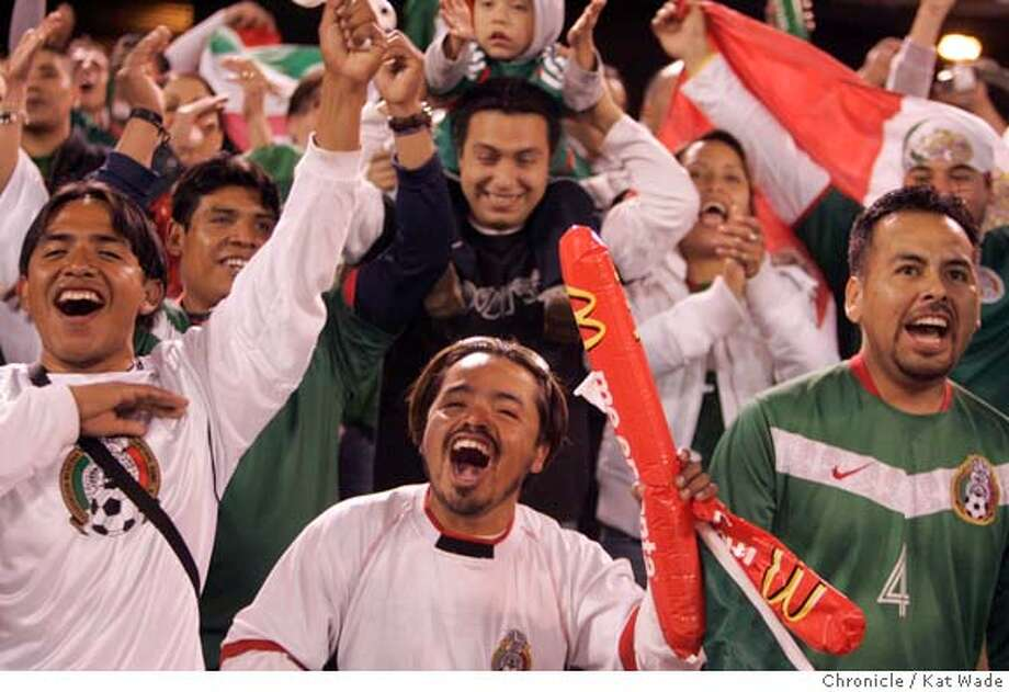 soccerfront_028_KW.jpg  Mexico fan's (L to R) Omar Perez, Adan Perez and David Perez cheer as their team takes the field for the sold out soccer game between Mexico and Ecuador on Wednesday March 27, 2007 at McAfee Coliseum in Oakland.  Kat Wade/The Chronicle  Ran on: 03-29-2007  Ricardo Osorio (2) celebrates Mexico's goal in the opening minutes, and fans (from left) Omar, Adan and David Perez cheer the arrival of their team on the Coliseum pitch Wednesday night.  Ran on: 03-29-2007  Mexico's Oscar Rojas (5) Gerardo Galindo collide with Ecuador's Edison Mendez during the first half of Mexico's 4-2 victory.  Ran on: 03-29-2007  Mexico's Oscar Rojas (5) Gerardo Galindo collide with Ecuador's Edison Mendez during the first half of Mexico's 4-2 victory.  Ran on: 03-29-2007  Mexico's Oscar Rojas (left) and Gerardo Galindo collide with Ecuador's Edison Mendez during the first half of Mexico's 4-2 victory. Photo: Kat Wade