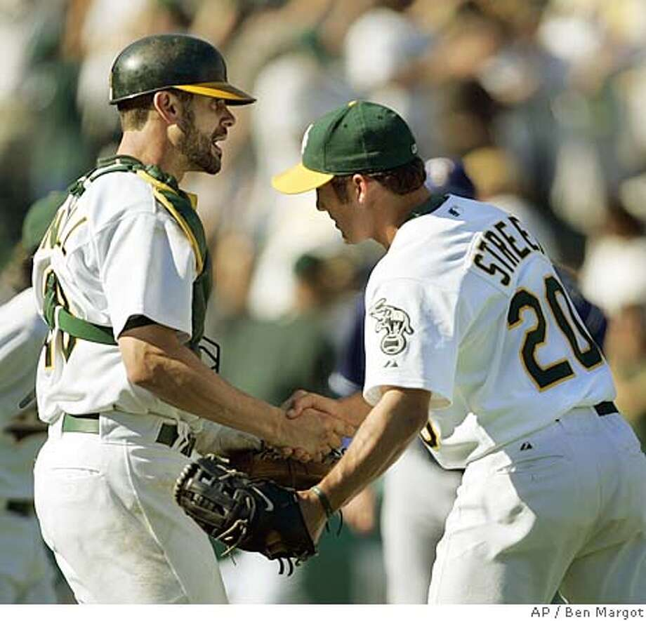 Oakland Athletics' catcher Jason Kendall, left, congratulates closing pitcher Houston Street at the end of their 7-6 win over the Texas Rangers Saturday, Sept. 24, 2005, in Oakland, Calif. (AP Photo/Ben Margot) Photo: BEN MARGOT