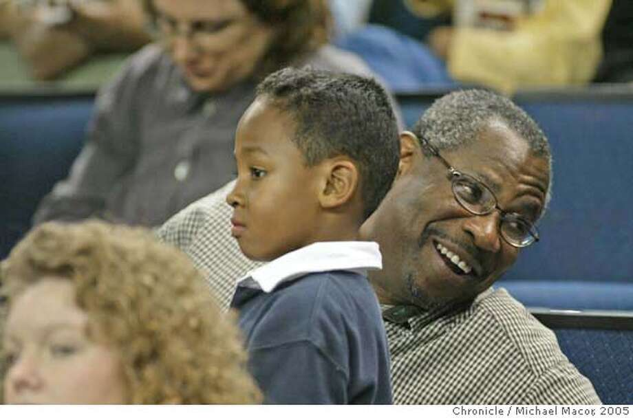 warriors_216_mac.jpg Former SF Giants manager Dusty Baker in the stands watching the action and talking to fans with son Darren. Pro Basketball Golden State Warriors vs. New Orleans Hornets. 2/4/05 Oakland, Ca Michael Macor / San Francisco Chronicle Mandatory Credit for Photographer and San Francisco Chronicle/ NO Sales- Magazine Out Photo: Michael Macor
