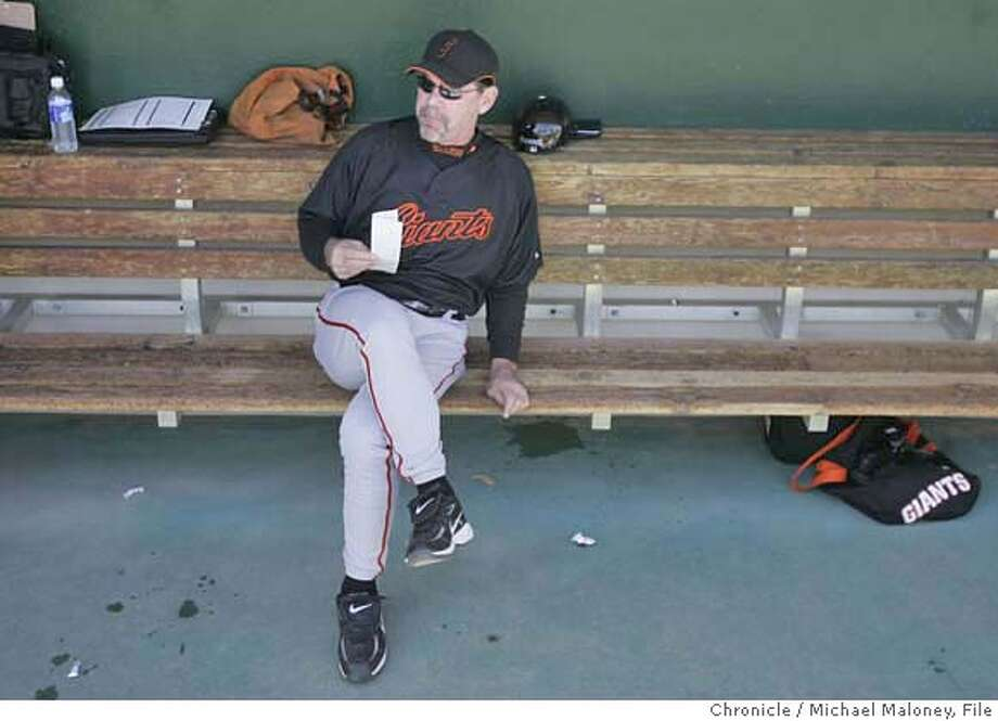 San Francisco Giants manager Bruce Bochy relaxes in the dugout prior to his first game as a Giant.  The San Francisco Giants play the Chicago Cubs in a spring training game at HoHoKam Stadium in Mesa, Arizona on March 1, 2007. The Giants won 9-2.  Photo by Michael Maloney / San Francisco Chronicle ***roster Bruce Bochy MANDATORY CREDIT FOR PHOTOG AND SF CHRONICLE/NO SALES-MAGS OUT Photo: Michael Maloney