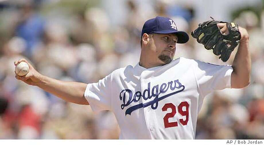 Los Angeles Dodgers' Jason Schmidt delivers a pitch during the first inning of their spring training baseball game against the Cleveland Indians, Sunday, March 25, 2007, in Vero Beach, Fla. The Dodgers won 4-3.(AP Photo/Bob Jordan) Photo: Bob Jordan