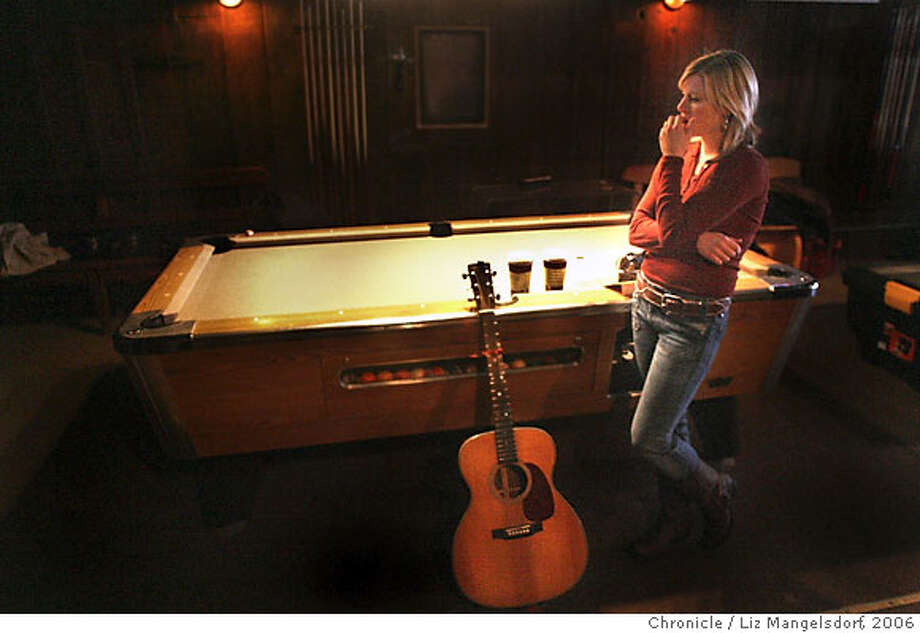 "rockstar23_135_lm.JPG  Victoria George, from Marin County, waits with her guitar at the pool table at the Rockit Lounge, waiting for her turn to audition.  Event on 3/22/06 in San Francisco.  The producers for CBS reality show ""Rock Star: The Series"" hold open auditions at the Rockit Room in San Francisco onclement St. at 5th ave. Liz Mangelsdorf / Photo: Liz Mangelsdorf"