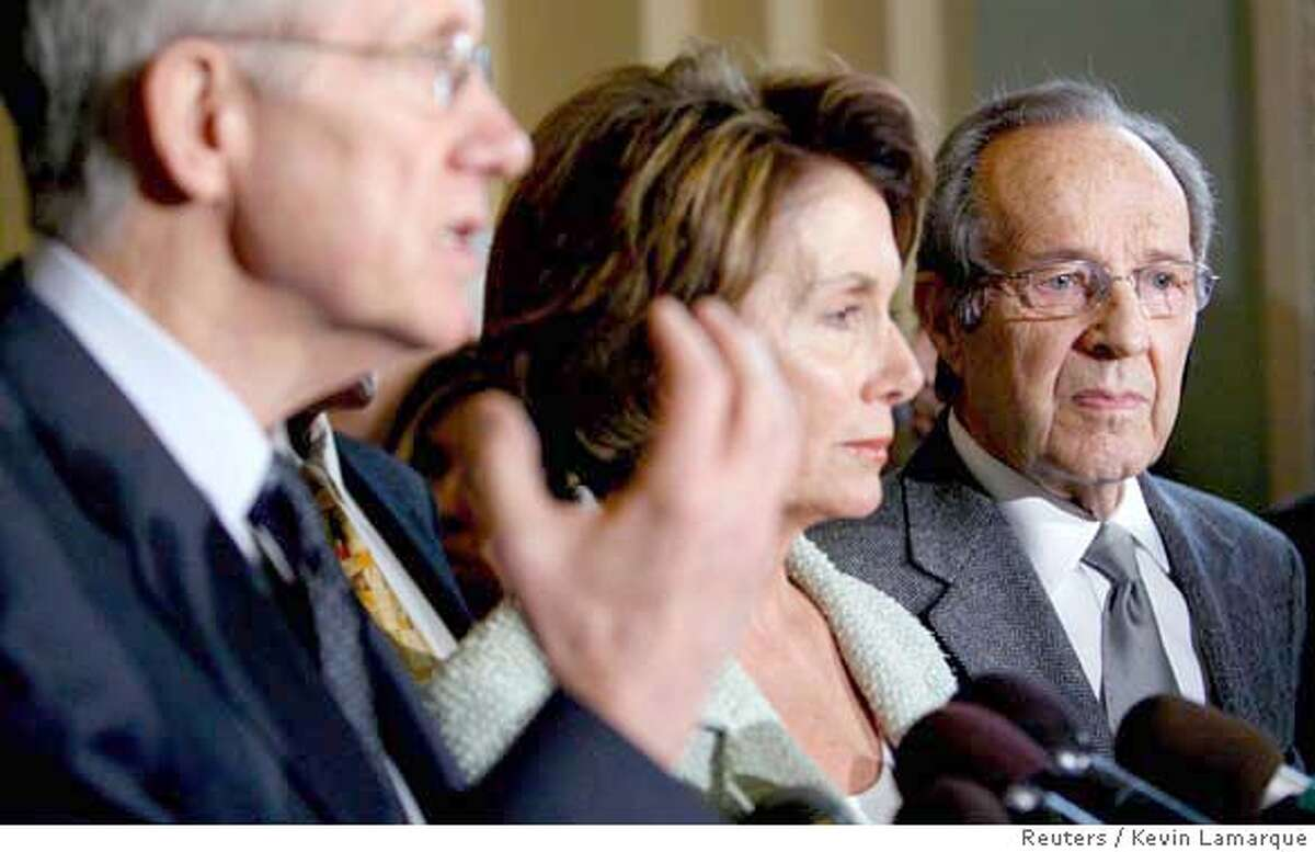 Senate Majority Leader Harry Reid, L, (D-NV) and Speaker of the House Nancy Pelosi (D-CA) are joined by former Secretary of Defense William Perry (R) as they speak to reporters about a new course in Iraq at the Capitol in Washington March 28, 2007. REUTERS/Kevin Lamarque (UNITED STATES)