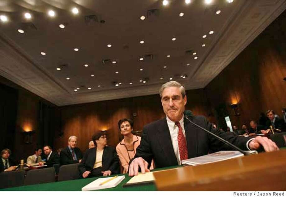 FBI director Robert Mueller prepares to testify at a Senate Judiciary Committee hearing on Capitol Hill in Washington March 27, 2007. The Senate panel wants to know if the Patriot Act needs to be revised to keep the FBI from illegally or improperly gathering telephone, e-mail and financial records of Americans and foreigners while pursuing terrorists. REUTERS/Jason Reed (UNITED STATES) 0 Photo: JASON REED