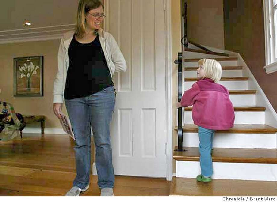 api_homes106.JPG  Kristen Stoller, left, is being urged by her two year old daughter Abigail to check out the upstairs in a 3 bedroom home at 5861 Margarido Drive in Rockridge district. The Stoller family is looking for a home in a good school district.  For many looking for a new home, the API or academic performance index, is an important consideration. Many with young children are very concerned about the quality of the local schools. In the Rockridge area of Oakland, many young families are interested in the high performing Chabot Elementary School. {Brant Ward/San Francisco Chronicle}3/25/07 Photo: Brant Ward