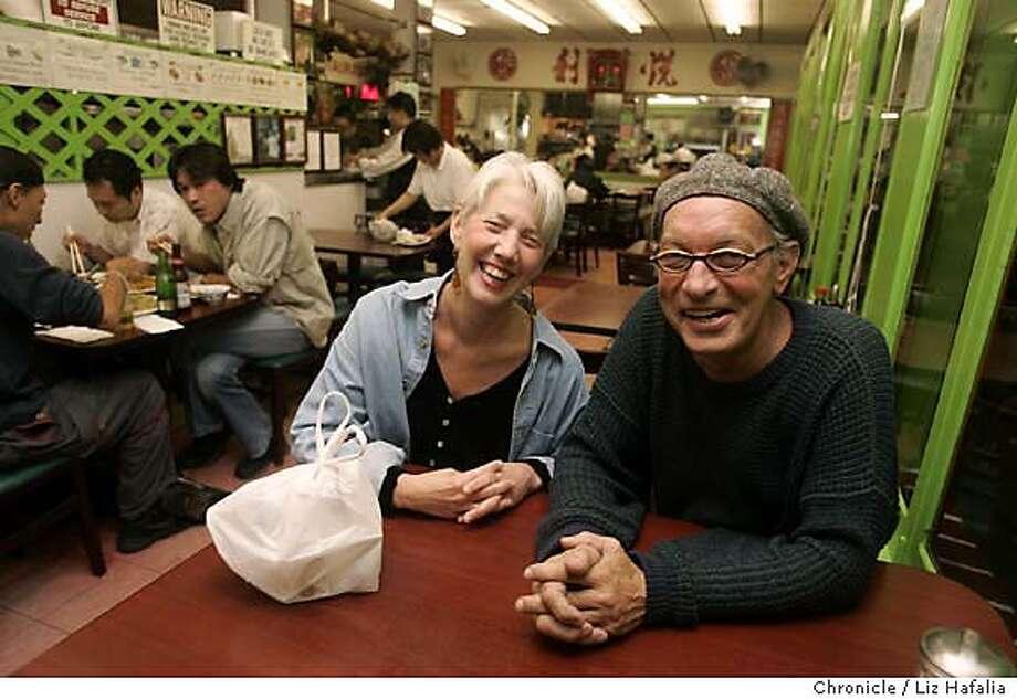 Philipe (cq) La Mancusa (getting cell Friday) and his girlfriend Debbie Lindsey at Yuet Lee restaurant. Photographed by Liz Hafalia on 9/16/05 in San Francisco, California. SFC Photo: Liz Hafalia