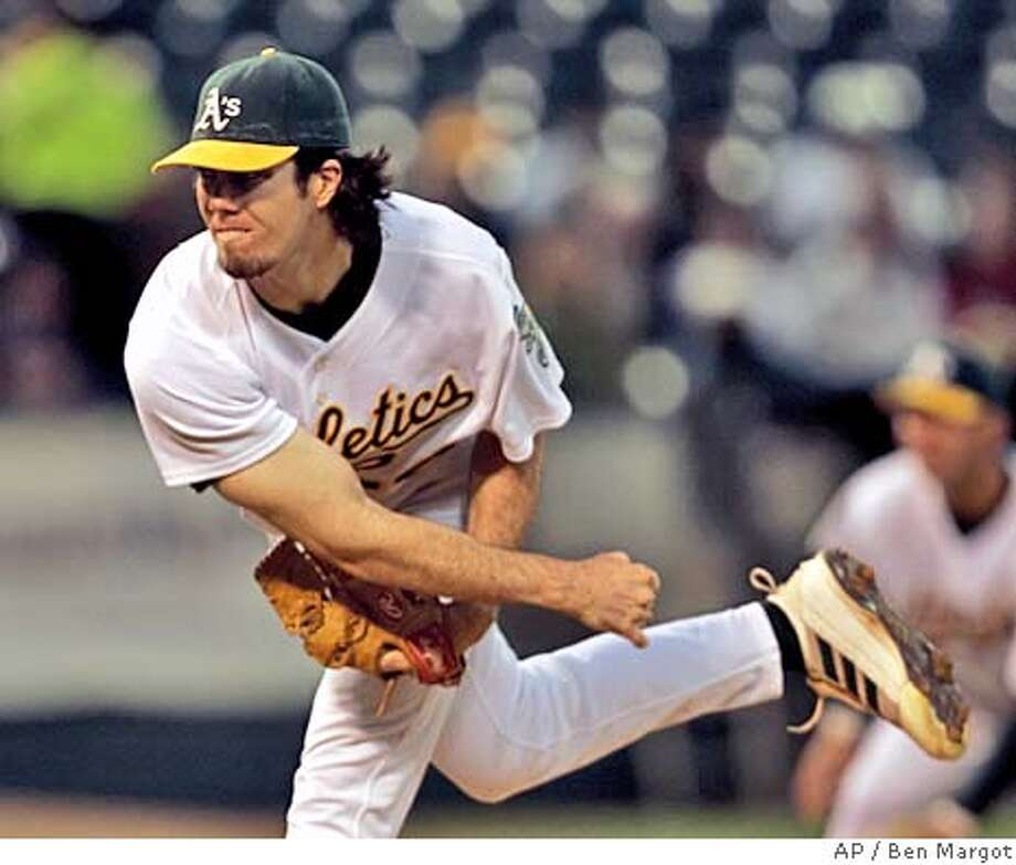 Oakland Athletics' Dan Haren follows through on a pitch to the Texas Rangers in the first inning Friday, Sept. 23, 2005, in Oakland, Calif. (AP Photo/Ben Margot) Photo: BEN MARGOT