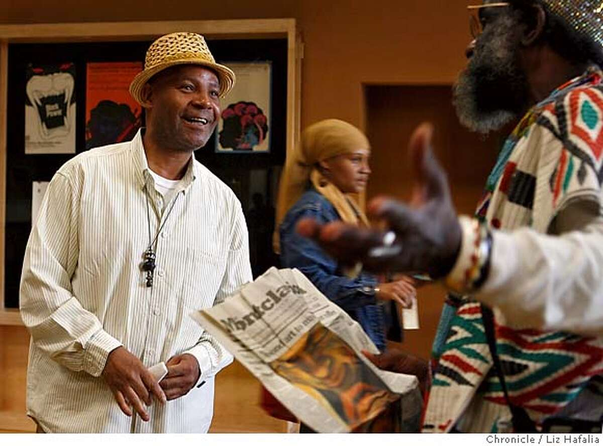 DOUGLAS_051_LH_.JPG Artist Emory Douglas, who has done a new book about his artwork of the Black Panthers, talking with Tahuti at his booksigning in the East Side Cultural Center. Liz Hafalia/The Chronicle/Oakland/3/17/07 **Emory Douglas, Tahuti cq �2007, San Francisco Chronicle/ Liz Hafalia MANDATORY CREDIT FOR PHOTOG AND SAN FRANCISCO CHRONICLE. NO SALES- MAGS OUT.