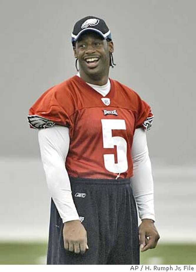 Philadelphia quarterback Donovan McNabb laugh during practice Wednesday, Sept. 14, 2005, in Philadelphia. McNabb watched practice after being hurt in the Monday night game against Atlanta. (AP Photo/H. Rumph Jr) Photo: H. RUMPH JR