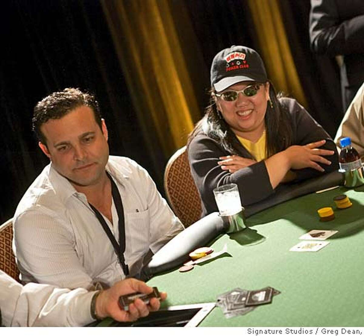 Jim Gerran of San Francisco and Noemi Agustin at the final table at Camp Hellmuth. Please credit: Greg Dean, Signature Studios