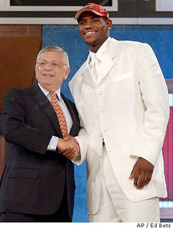 NBA Commissioner David Stern, left, congratulates LeBron James after he was chosen by the Cleveland Cavaliers as the overall first pick of the 2003 NBA Draft Thursday, June 26, 2003 in New York. (AP Photo/Ed Betz) Photo: ED BETZ