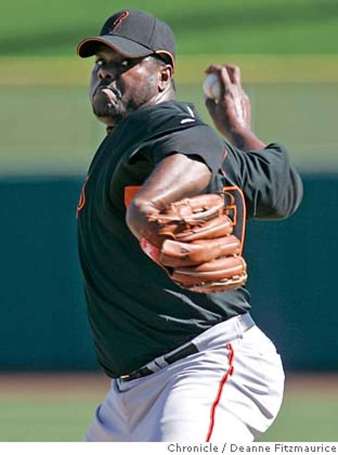 giants_0613_df.jpg  Armando Benitez throws pitches during batting practice. The San Francisco Giants have a spring training workout at Scottsdale Stadium. Photographed in Scottsdale on 2/21/07. Chronicle Photo / Deanne Fitzmaurice Ran on: 02-22-2007  Armando Benitez throws to hitters for the first time in 51-2 months at the Giants' training camp. Mandatory credit for photographer and San Francisco Chronicle. No Sales/Magazines out. Photo: Deanne Fitzmaurice