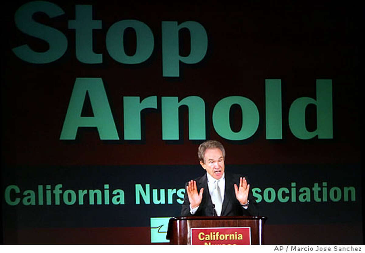 Actor Warren Beatty addresses members of the California Nurses Association on Thursday, Sept. 22 in Oakland, Calif. Beatty, a Democrat who has been mentioned as a possible challenger to Gov. Arnold Schwarzenegger next year, has in the past few months emerged as one of the governor's most visible and vociferous critics. (AP Photo/Marcio Jose Sanchez)