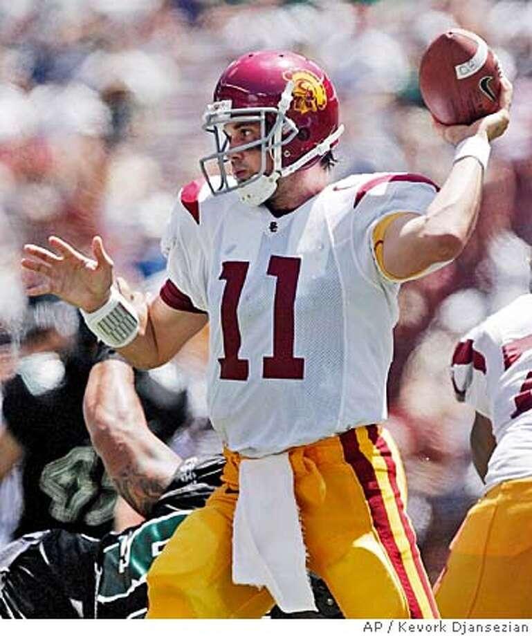 Southern California's Heisman trophy-winning quarterback Matt Leinart throws a pass during Trojans' season-opener against Hawaii, Saturday, Sept. 3, 2005, at Aloha stadium in Honolulu. USC won, 63-17. (AP Photo/Kevork Djansezian) Photo: KEVORK DJANSEZIAN