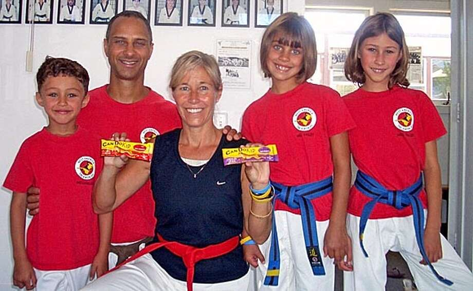 NBCANDO.JPG The Luster Family that won Family of the Year 2004 from Mill Valley Martial Arts Studio West America Tae Kwon Do. From left to right: John, Robert, Deborah, Emily and Sarah. They are holding their Can Do bars. HANDOUT HANDOUT Photo: HANDOUT