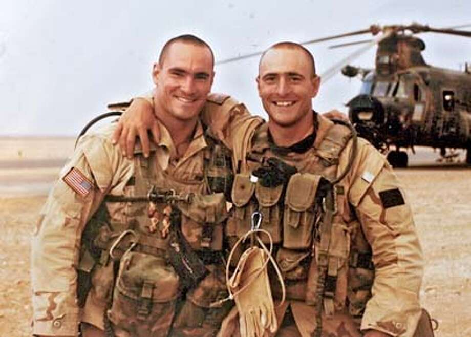 COPY PHOTO of (L)Pat Tillman and his brother (R) Kevin, in Saudi Arabia, 2003.  Profile of Mary Tillman, mother of Pat Tillman (the football star who was killed by friendly fire in Afghanistan). This is for an A1 centerpiece story about Pentagon coverup of the case. She has big binders of the Pentagon files in the case that she has pored over, and a good portrait might be to have her spread them over her kitchen table (this image is described in the article)  Also please pick up other photos and documents that she will give you to bring back to the Chronicle Graphics Dept for illustration purposes. Ran on: 09-25-2005  Pat Tillman, who gave up a career in the NFL that would have made him a millionaire so he could instead fight terrorism as an Army Ranger, died from friendly fire in Afghanistan. Ran on: 09-25-2005  Pat Tillman, who gave up a career in the NFL that would have made him a millionaire so he could instead fight terrorism as an Army Ranger, died from friendly fire in Afghanistan. Photo: Koci-Hernandez, Christina