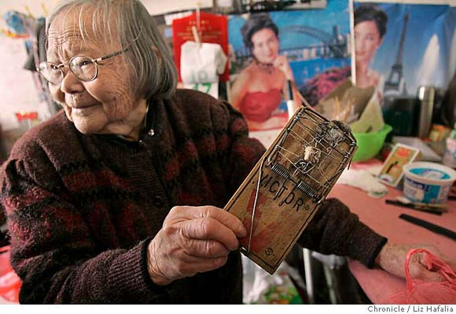 CHINATOWN20_053_LH.JPG Qiong Zhen Xu (cq), 84 years old, carrying the 39th mouse she caught in her trap since the month of March. A Chinatown group reports on rampant substandard living conditions in the neighborhood�s rental housing. Photographed by Liz Hafalia on 9/20/05 in San Francisco, California. SFC Creditted to the San Francisco Chronicle/Liz Hafalia Photo: Liz Hafalia