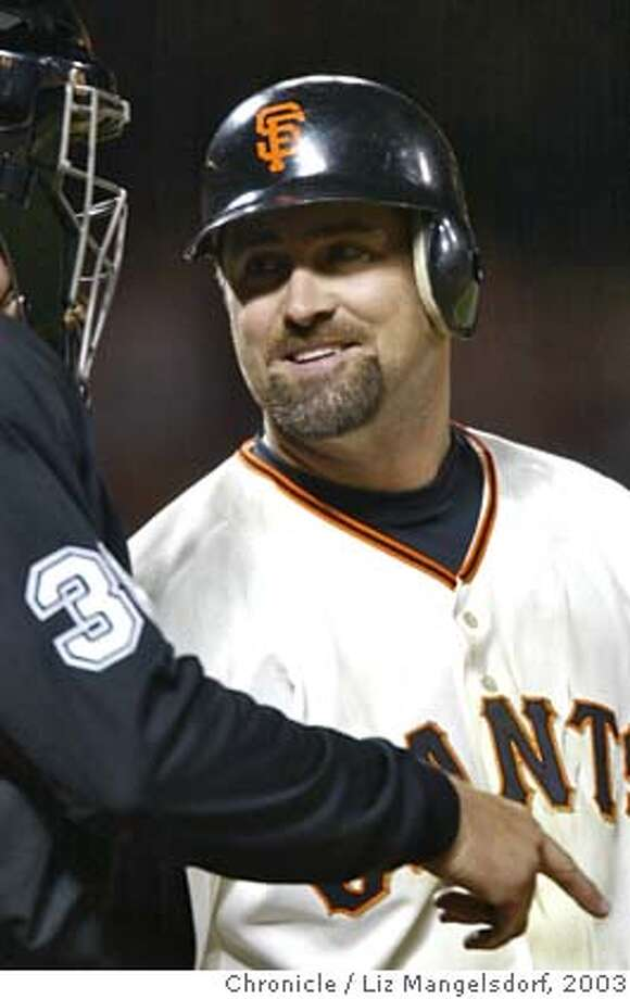 giants045_LM.jpg Rich Aurilia smiles as he talks with the umpire near the end of the game.  Event on {Aug. 22, 2003} in San Francisco.  giants beat the Marlins at Pac Bell Park. LIZ MANGELSDORF / The Chronicle MANDATORY CREDIT FOR PHOTOG AND SF CHRONICLE/NO SALES-MAGS OUT Photo: LIZ MANGELSDORF