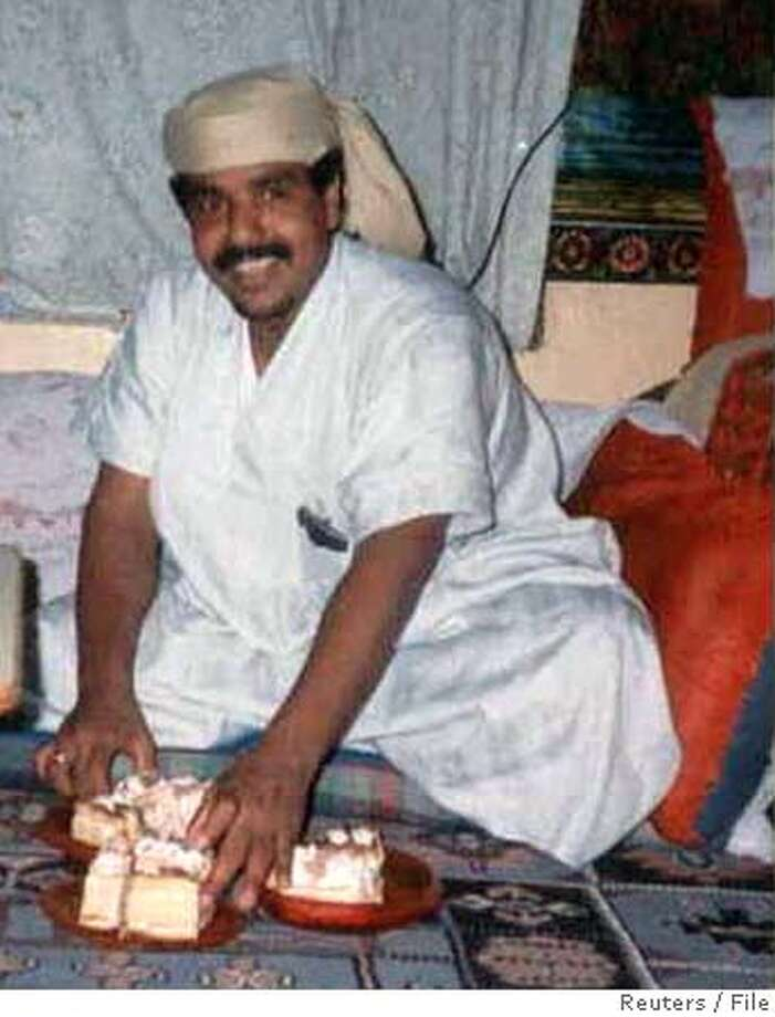 Undated photo of Salim Ahmed Hamdan, released by his attorneys August 24, 2004. Hamdan was apprehended in Afghanistan in November 2001 and has been detained at the U.S. naval base at Guantanamo Bay, Cuba since then. The United States convened its first war crimes tribunal since World War Two on August 24, 2004 and formally charged Yemeni citizen Hamdan, described as Osama bin Laden's driver, with conspiracy to commit murder as a member of al Qaeda. The United States has charged four of the 585 al Qaeda or Taliban suspects at Guantanamo with conspiracy to commit war crimes, a charge that carries a maximum penalty of life in prison. Hamdan was the first to go before the controversial military tribunals authorized by President George W. Bush for trying foreign militants after the Sept. 11, 2001, attacks on New York and Washington, in which about 3,000 people were killed. REUTERS/Handout Ran on: 08-25-2004  Salim Ahmed Hamdan admits he was a driver for Osama bin Laden but denies ties to terror. Ran on: 08-25-2004  Salim Ahmed Hamdan admits he was a driver for Osama bin Laden but denies ties to terror. Ran on: 01-19-2005  Salim Ahmed Hamdan, caught in Afghanistan in 2001, has been held at the U.S. Navy base in Cuba ever since. Ran on: 01-19-2005  Salim Ahmed Hamdan, caught in Afghanistan in 2001, has been held at the U.S. Navy base in Cuba ever since. Ran on: 07-16-2005  Salim Ahmed Hamdan 0 Photo: HO