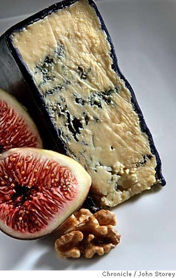 Roaring 40's Cheese from Australia with figs and walnuts. John Storey San Francisco Event on 9/1/05  - Photo: John Storey