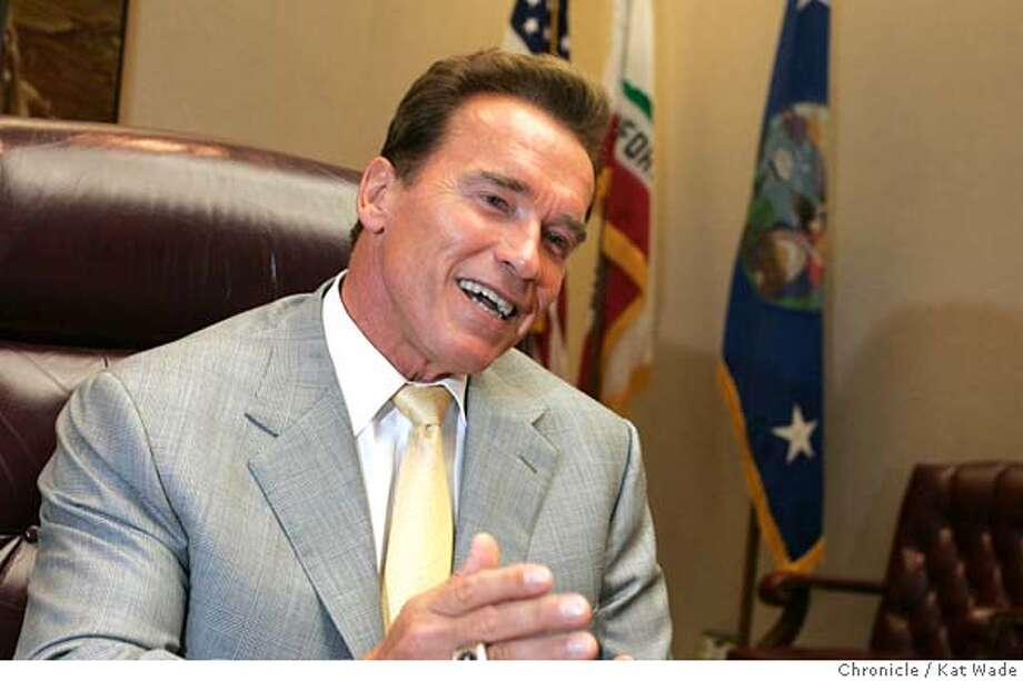GOVERNOR21_002_KW.jpg  On 9/20/05 in Sacramento Governor Arnold Schwarzenegger gives the Chronicle reporter Carla Marinucci a private interview in his office Tuesday afternoon.  Kat Wade/ The Chronicle MANDATORY CREDIT FOR PHOTOG AND SF CHRONICLE/ -MAGS OUT Photo: Kat Wade