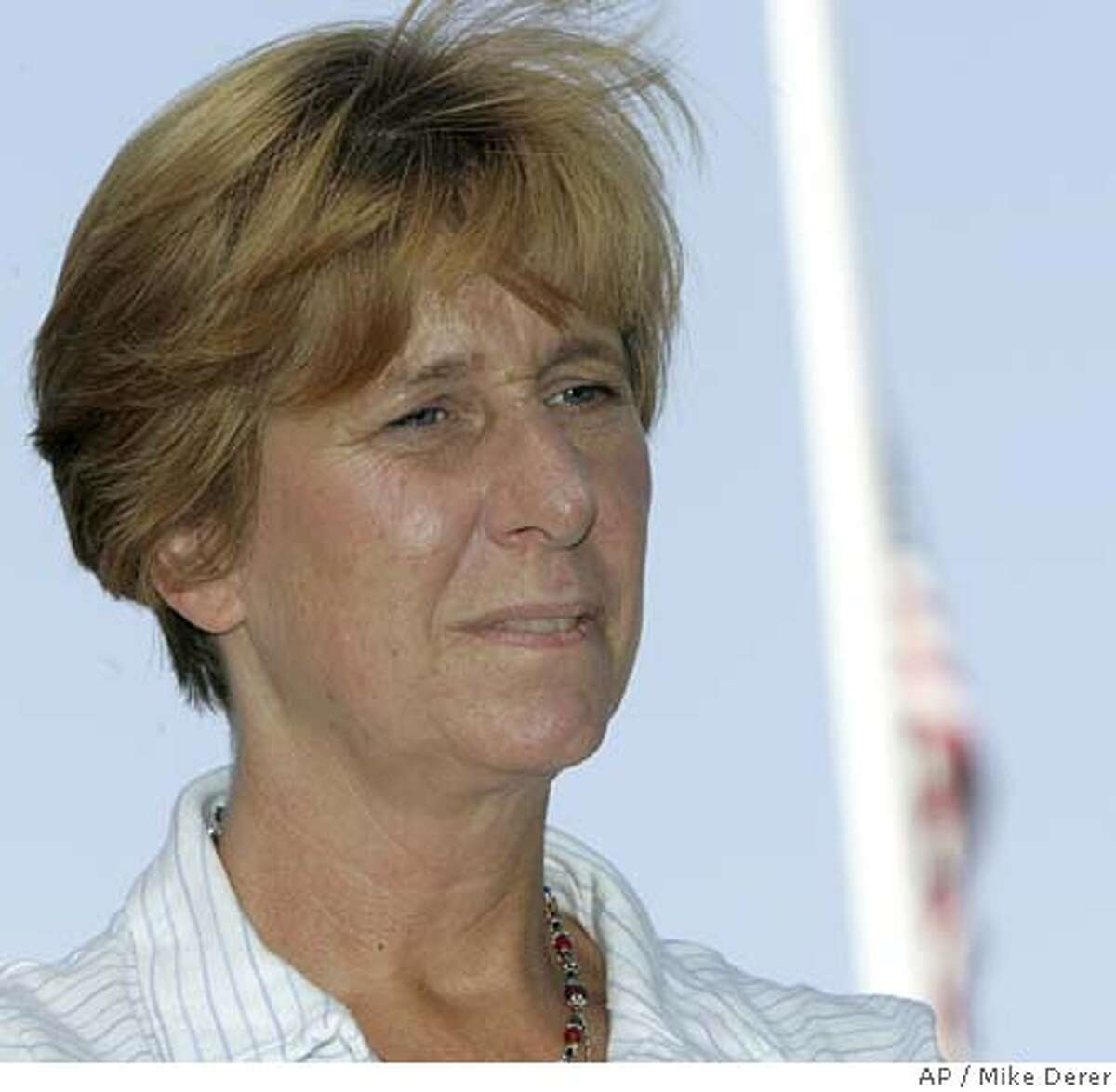 Cindy Sheehan listens during a news conference in Westfield, N.J., on Monday, Sept. 12, 2005, with U.S. Rep. Frank Pallone, D-N.J. Sheehan, the California woman who camped outside President Bush's Texas ranch last month to protest the war in Iraq, which claimed her soldier son's life, said Monday she believes the U.S. never plans to leave Iraq. (AP Photo/Mike Derer)