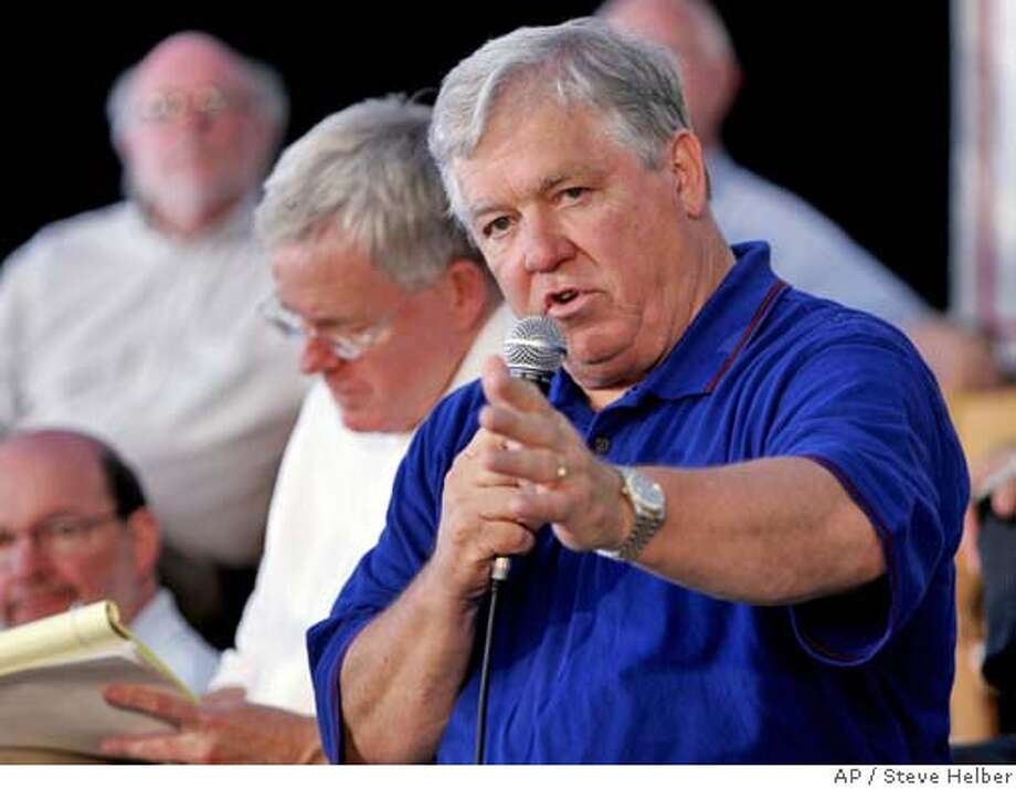 Mississippi Gov. Haley Barbour gestures during a town meeting on his Commission on Recovery, Rebuilding and Renewal, along with commission chairman Jim Barksdale, left, in Gulfport Miss., Tuesday, Sept. 20, 2005. Barbour met with President Bush earlier in the day to brief him on the rebuilding plans. (AP Photo/Steve Helber) Photo: STEVE HELBER