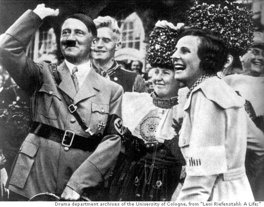 """Caption from the book: """"On the best of terms: Leni Riefenstahl and Adolf Hitler on the sidelines during the filming of 'Triumph of the Will' in 1934.""""  Credit: Drama Department Archives of the University of Cologne, From """"Leni Riefenstahl: A Life"""" FOR USE WITH BOOK REVIEW ONLY Photo: Drama Department Archives Of The"""