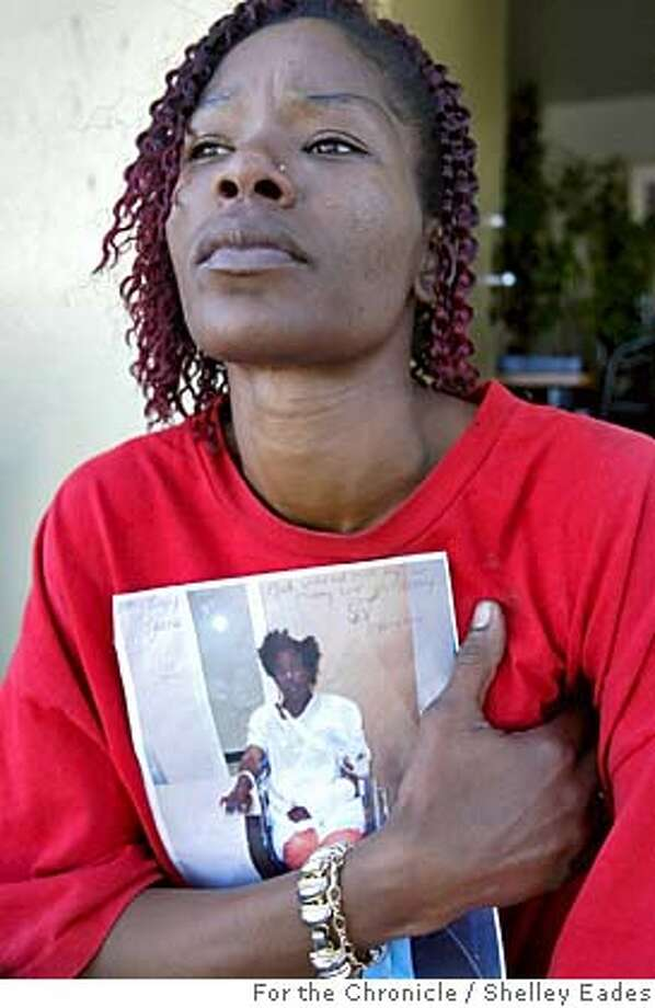 shooting127se.JPG On 9/16/05 in San Francisco.  Tami Butler, 38 holds a picture of her son Tyrelle Taylor, 18, who was shot September 9th in Hunter's Point. Chronicle Photo by Shelley Eades /mags out mandatory credit photog and Chronicle Photo: Shelley Eades