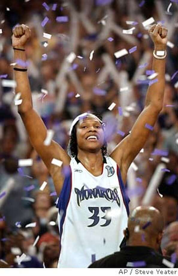 Sacramento Monarchs center Yolanda Griffith celebrates her team's win over the Connecticut Sun for the 2005 WNBA Championship in Sacramento, Calif., on Tuesday, Sept. 20, 2005. Sacramento won 62-59 and Griffith was named MVP of the Finals.(AP Photo/Steve Yeater) Photo: STEVE YEATER