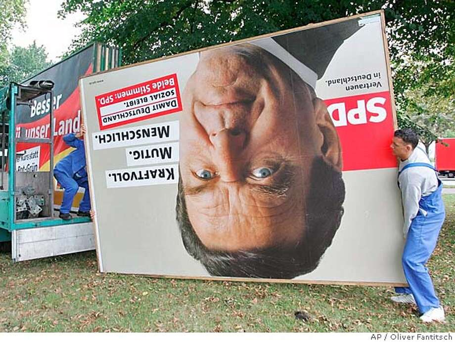 An election poster with the portrait of German chancellor Gerhard Schroeder is loaded in a truck in Hamburg, northern Germany on Monday, Sept. 19, 2005. Germany's political leaders on Monday began the tortuous process of trying to form a new government after an inconclusive election that left Angela Merkel's conservative party well short of a clear mandate to deepen economic reform.(AP Photo/Oliver Fantitsch) Photo: OLIVER FANTITSCH