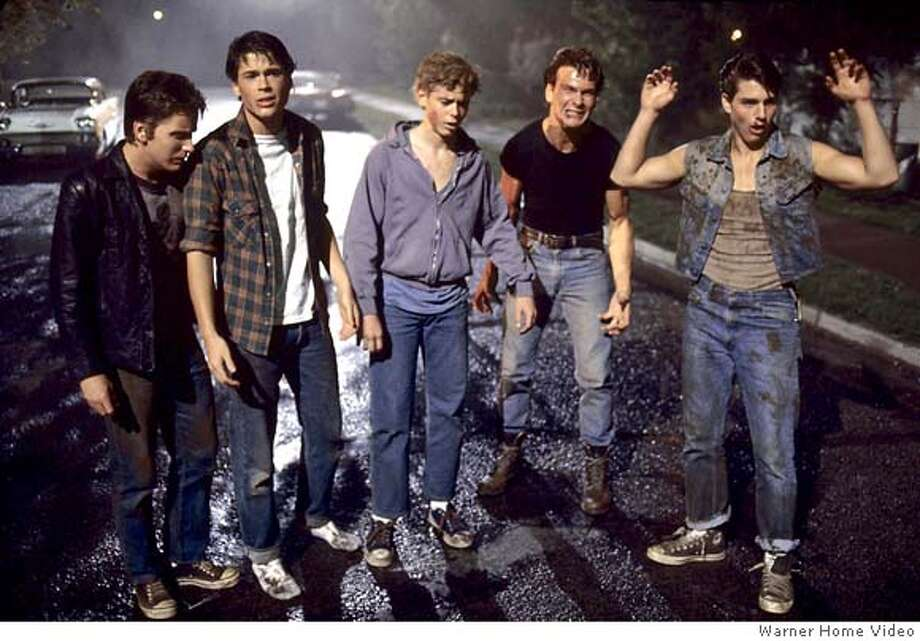 "(NYT14) TULSA, Okla. -- Sept. 7, 2005 -- HINTON-OUTSIDERS-2 -- From Left, Emilio Estevez, Rob Lowe, C. Thomas Howell, Patrick Swayze and Tom Cruise in the 1983 film ""The Outsiders,"" directed by Francis Ford Coppola. The film is being released in theaters and on DVD in a new cut by its director. (Warner Home Video) XNYZ Photo: WARNER HOME VIDEO"