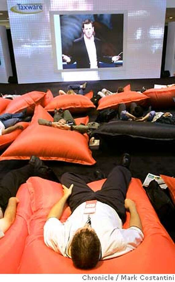 Oracle21_075_mc.jpg  Overflow crowd crashes out on pillows to catch Sun Microsystems' Scott McNeely's keynote speech on a monitor.  Scenes at the Oracle Convention at Moscone Center.  Photograph by Mark Costantini/S.F. Chronicle. MANDATORY CREDIT FOR PHOTOG AND SF CHRONICLE/ -MAGS OUT Photo: Mark Costantini
