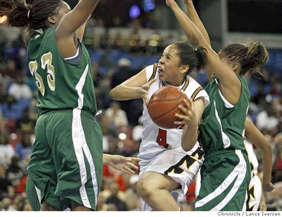 BERKELEY_15536.JPG  Berkeley's #4 Dominique Williams-McNac drives to the basket between two Poly defenders in first half action. Northern Cal Division One CIF Champion Berkeley Vs. Southern Cal Division One CIF Champions Poly, won March 24, 2007, in SACRAMENTO, at Arco Arena.  Williams-McNac (cq, program)  Photo By Lance Iversen / The Chronicle  Photo taken on 3/24/07, in SACRAMENTO, CA. Photo: By Lance Iversen