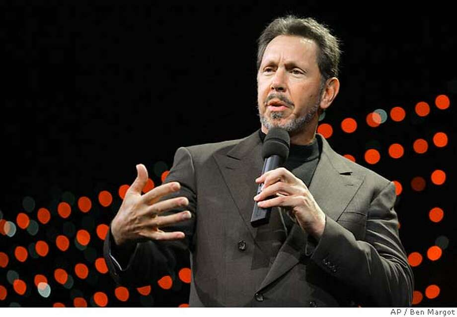 ** FILE ** In a file photo Oracle chief executive Larry Ellison gestures while delivering the keynote address to Oracle customers Wednesday, Dec. 8, 2004, in San Francisco. The business software company Oracle Corp. on Monday, Sept. 12, 2005, said it will acquire Siebel Systems Inc., which makes software to help companies manage relationships with their customers, in a deal worth about $5.85 billion in cash and stock. (AP Photo/Ben Margot) Ran on: 09-13-2005  Larry Ellison may have settled a suit over alleged insider trading, but he still faces another one. DEC. 8, 2004, PHOTO Photo: BEN MARGOT