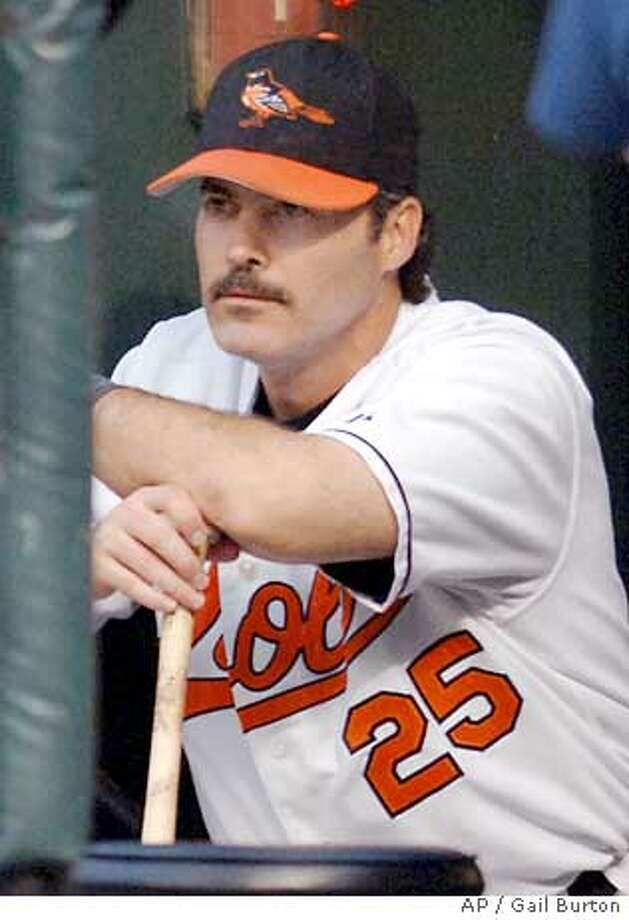 ** FILE ** Baltimore Orioles' Rafael Palmeiro watches the Orioles game against the Tamap Bay Devil Rays, in this Aug. 11, 2005 file photo, in Baltimore. Palmeiro has been sent home to Texas, where he likely will ponder the possibility of returning next year while rehabilitating knee and ankle injuries that have further ruined what was once a rewarding season. (AP Photo/Gail Burton) Ran on: 09-19-2005  Rafael Palmeiro took a lot of heat upon his return from a steroid suspension. Barry Bonds might face a similar reaction when the Giants hit the road. Ran on: 09-19-2005  Rafael Palmeiro took a lot of heat upon his return from a steroid suspension. Barry Bonds might face a similar reaction when the Giants hit the road. Photo: GAIL BURTON