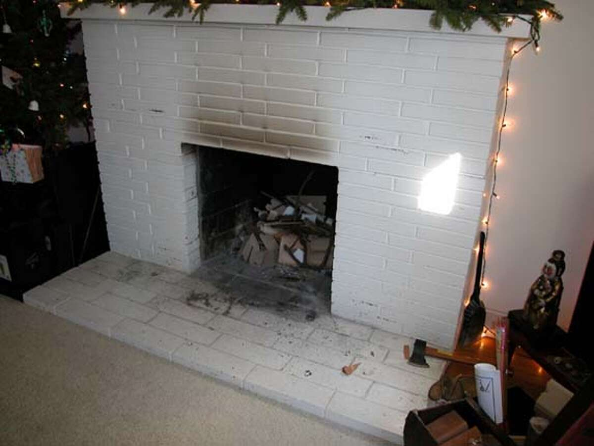 This goes with sweat equity column for 3-24-2006. Reader wants to know how to remove bricks and hearth from her old fireplace and replace them with tile.