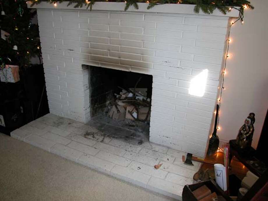 This goes with sweat equity column for 3-24-2006. Reader wants to know how to remove bricks and hearth from her old fireplace and replace them with tile. Photo: From Reader