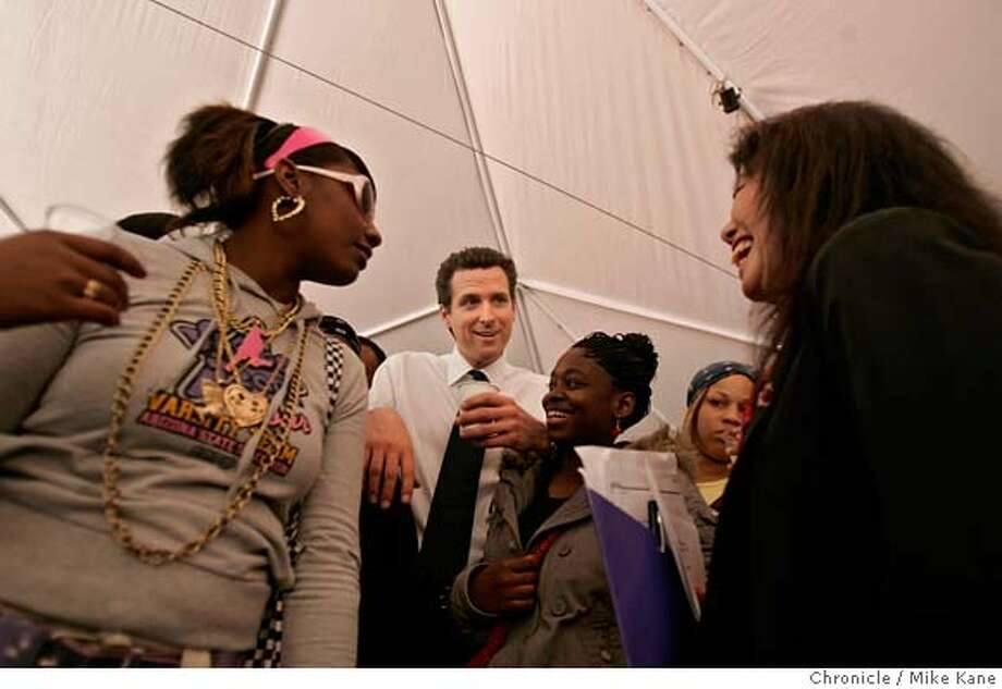 GLIDE_GROUND_097_MBK.JPG  San Francisco Mayor Gavin Newsom jokes around with YouthBuild participants Mikaela Unique, 18, (from left), Marqueisia Seymore, 19, and Executive Director and President of the Glide Foundation Janice Mirikitani during a ground-breaking ceremony for two affordable housing and community-serving commercial retail projects developed by Glide Economic Development Corporation in conjunction with Tenderloin Neighborhood Development Corporation and Millenium Partners/ MP Mason Street LLC on Mason Street in San Francisco, CA, on Thursday, March, 22, 2007. photo taken: 3/22/07 Mike Kane / The Chronicle **Janice Mirikitani Mikaela Unique Marqueisia Seymore Gavin Newsom MANDATORY CREDIT FOR PHOTOG AND SF CHRONICLE/NO SALES-MAGS OUT Photo: MIKE KANE