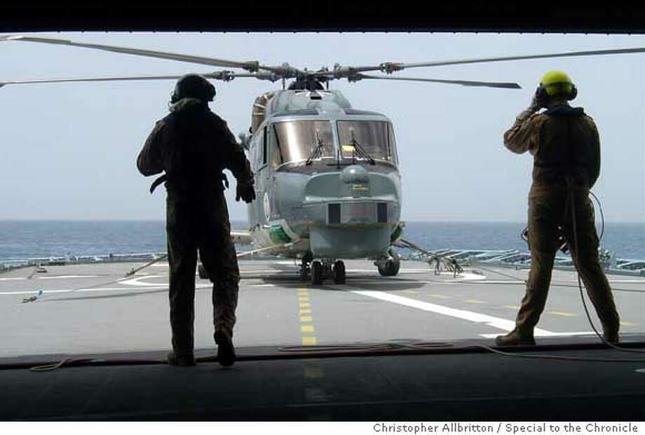 One of two Sea-Lynx helicopters lands on the Bremen's flight deck in the Gulf of Aden. Aboard the German frigate Bremen off the Horn of Africa. Christopher Allbritton/Special to the Chronicle  Ran on: 03-24-2007  A helicopter lands aboard a German frigate that is part of a task force patrolling the Gulf of Aden.  Ran on: 03-24-2007  A helicopter lands aboard a German frigate that is part of a task force patrolling the Gulf of Aden. Photo: Christopher Allbritton
