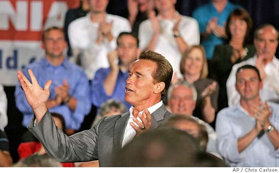 "California Gov. Arnold Schwarzenegger announces his intention to run for re-election during his third ""Conversations with Californians,"" a town hall-style meeting, Friday, Sept. 16, 2005, in San Diego. (AP Photo/Chris Carlson) Photo: CHRIS CARLSON"