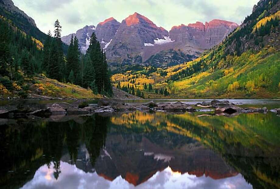 TRAVEL ASPEN -- The Maroon Bells with fall colors. Photo: Daniel Bayer