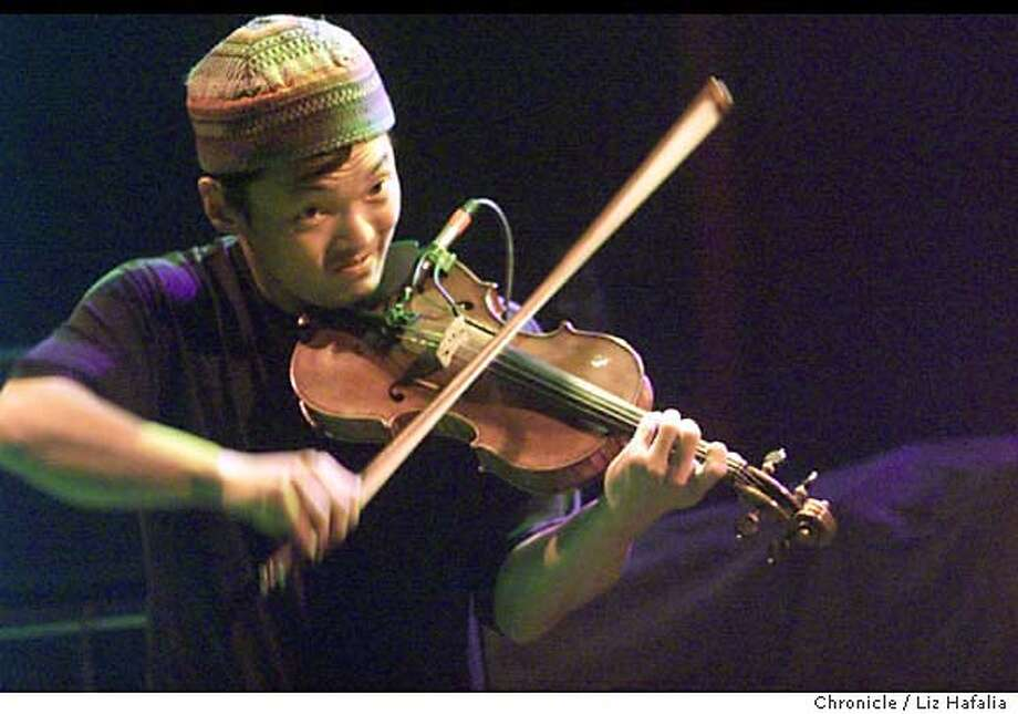 STRING09b-C-08MAR01-DD-LH --Michael Kang of String Cheese Incident playing his violin at the Warfield.  (BY LIZ HAFALIA/THE SAN FRANCISCO CHRONICLE) Photo: LIZ HAFALIA