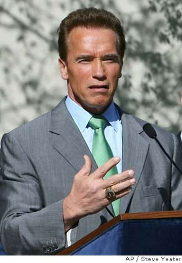 California GOV. Arnold Schwarzenegger, at podium, answers questions before signing SB113 which will move California's presidential primary election from June to February during a ceremony at the Leland Stanford Mansion in Sacramento, Calif., Thursday, March 15, 2007. Also shown are, from left, Senate President Pro Tem Don Perata, D-Oakland; Assembly Speaker Fabian Nunez, D-Los Angeles; and Sen. Ron Calderon, D-Montebello. (AP Photo/Steve Yeater)  Ran on: 03-16-2007  Sen. Hillary Clinton  Ran on: 03-16-2007  Sen. Hillary Clinton  Ran on: 03-16-2007  Sen. Hillary Clinton  Ran on: 03-16-2007  Sen. Hillary Clinton  Ran on: 03-16-2007  Sen. Hillary Clinton Photo: Steve Yeater