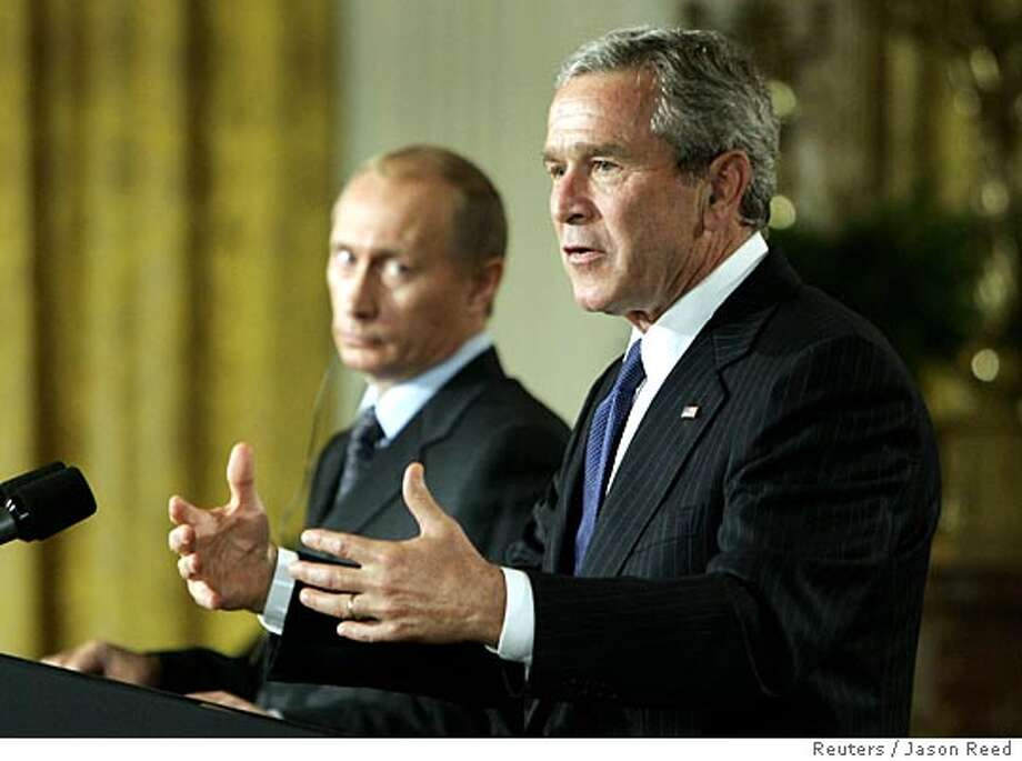 U.S. President George W. Bush (R) speaks alongside Russian President Vladimir Putin during their joint remarks in the East Room of the White House in Washington September 16, 2005. Bush said at the news conference on Friday that diplomacy would govern the timing of any push it makes to refer Iran to the U.N. Security Council over its nuclear program. REUTERS/Jason Reed Photo: JASON REED