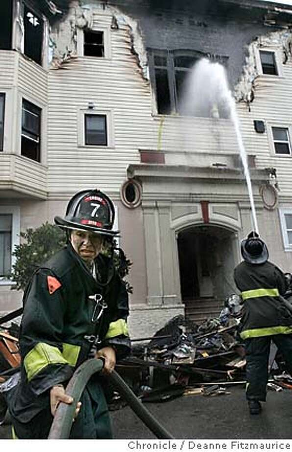 Firefighter Sadie Magaly helps with the hose. Firefighters are on the scene after an early morning fire on Capp Street in the Mission District.  Deanne Fitzmaurice / San Francisco Chronicle Photo: Deanne Fitzmaurice
