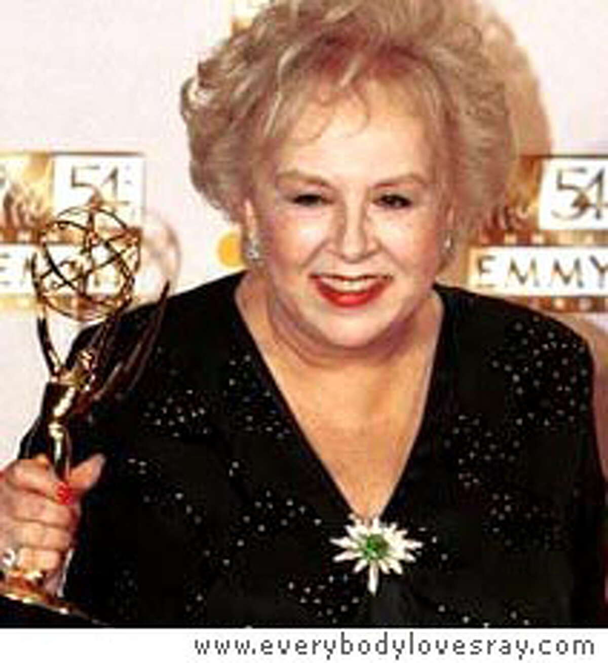 "Doris Roberts of ""Everybody Loves Raymond"" holds her Emmy award in 2002. Photo courtesy of www.everybodylovesray.com"